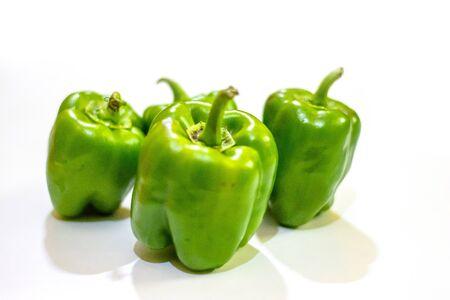 Foto für Fresh green capsicum or bell pepper isolated on a white background - Lizenzfreies Bild