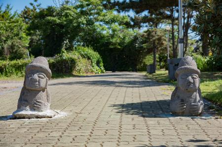 DOL hareubangs near the Yongduam Dragon Head Rock, Jeju Island, Korea.OL hareubangs, also called tol harubangs, hareubangs, or harubangs, are large statues found on Jeju Island off the southern tip of South Korea.