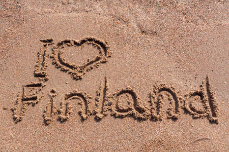 Photo for I love Finland handwritten on a sandy beach - Royalty Free Image