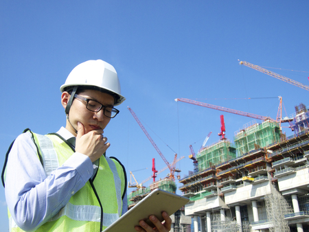 Construction worker using tablet