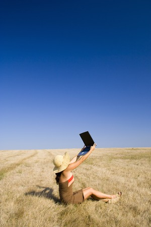 Woman having fun with tecnology in the nature