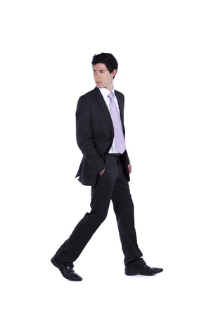 Photo pour Businessman walking and looking back isolated on white (some motion blur) - image libre de droit