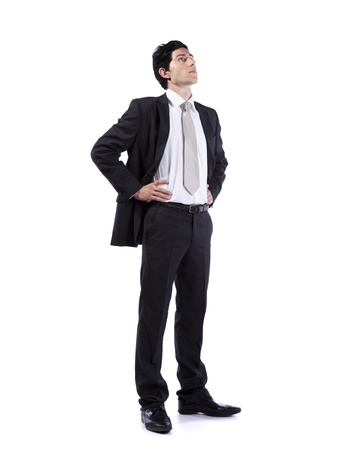 Photo pour Successful businessman looking up to the copy space (isolated on white) - image libre de droit