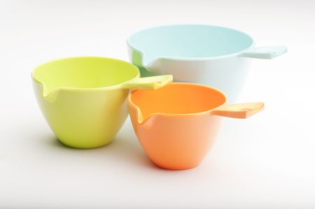 Close-up Of Three Plastic Measuring Cups