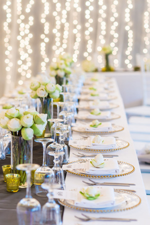 Elegance table set up with lotus flowers, selective focus.