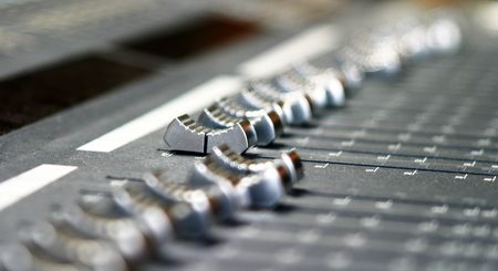 close up of and autio mixing xonsole in a music studio