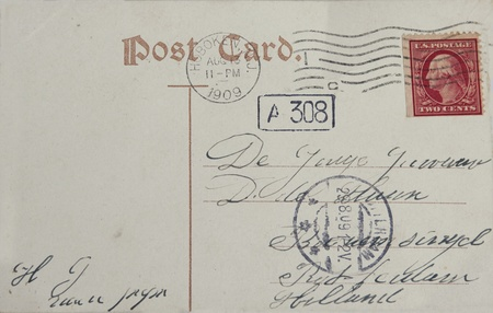 Vintage postcard with red two cent stamp and postmarked Hoboken in 1909. Address in Rotterdam, the Netherlands