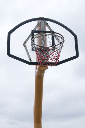 A basketball hoop with a white sky background