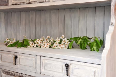 Flowering pear branch in an old shabby chic cabinet