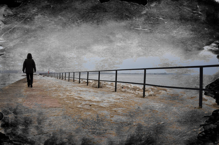 Photo pour Creative grungy textured image of lonely person walking on pier. - image libre de droit