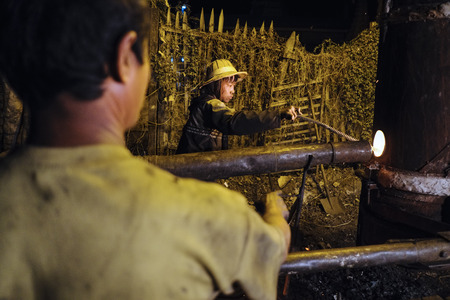 Workers in a foundry, Nyaung Shwe, Shan State, Myanmar