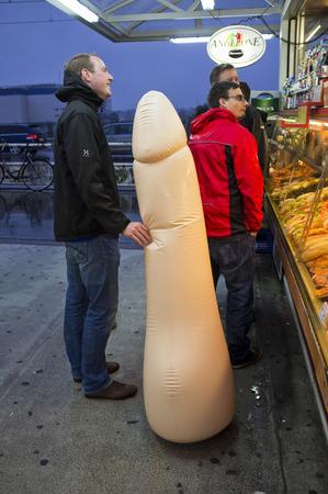 Men with practical joke device, Berlin; Germany