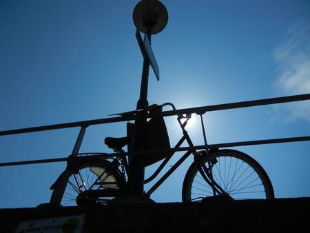 bicycle silhouette on bridge