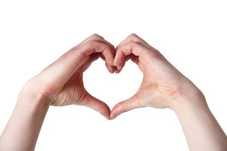 Photo for Two hands clasped together making a heart shape - Royalty Free Image