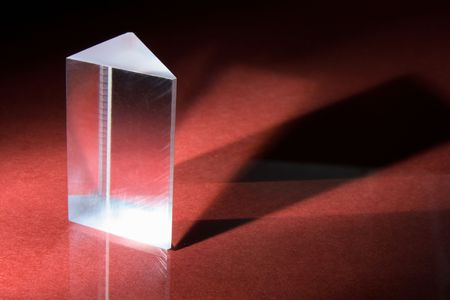Glass Prism on Red Background