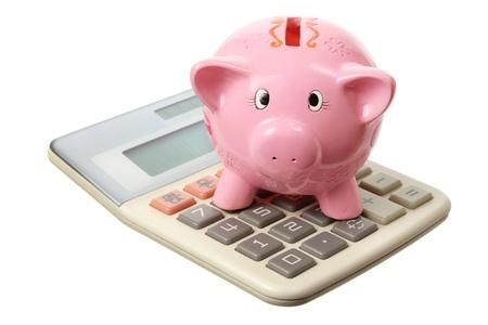 Piggybank and Calculator on White Background