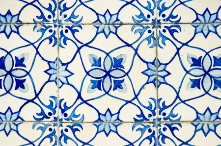 Portuguese azulejos, old tiled blue background.
