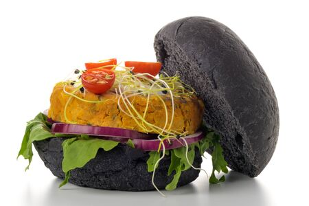 Photo pour Tasty grilled veggie burger with chickpeas and vegetables on black bread on white background. - image libre de droit