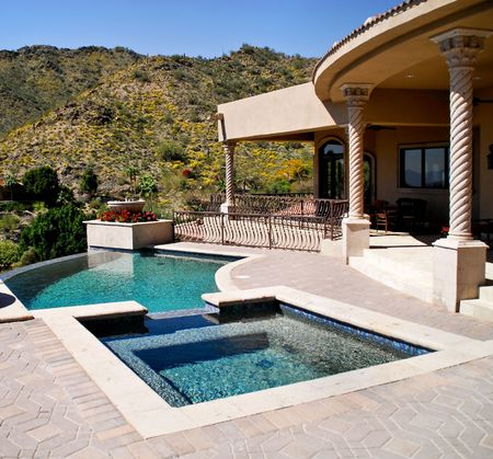 backyard patio and view of pool and spa