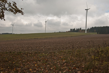 aerogeneratoers in autumn landscape with fields and meadows