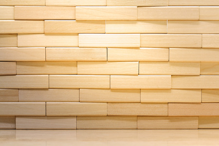 Photo pour Wooden brick wall made from wood blocks under sunlight for background and wallpaper - image libre de droit