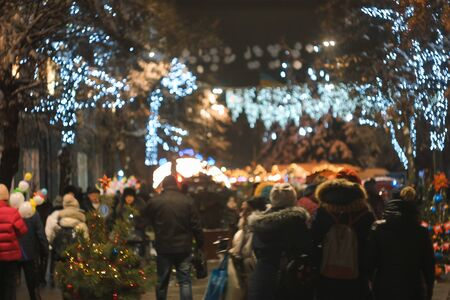 Photo pour Decorated christmas tree at night street with balls, toys, lamps and garlands - image libre de droit