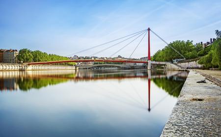 Photo pour Wide red bridge over the Soane Lyon city in France - image libre de droit
