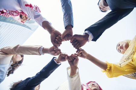 Photo pour Multiethnic group of young collaboration team standing hands together . Teamwork Concepts. - image libre de droit