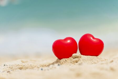 Photo pour Two Hearts couple lover symbol on honeymoon day trip in tropical paradise island with banner copy space. Romantic red hearts objects on wedding anniversary for couple lover. Honeymoon tourism concept. - image libre de droit