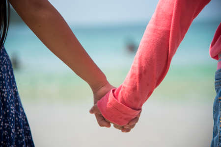 Photo for kids holding hands together, friendship concept. Family childhood brother and sister play together in summer times. Happiness love relationship - Royalty Free Image