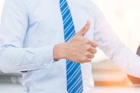 Photo for Satisfaction happy businessman showing thumbs up for good work. Positive idea hand of business people.  Thumbs up good sign in office with copy space. business office concept - Royalty Free Image