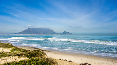 Early morning view of Cape Town and Table Mountain with Lion's Head and Signal Hill on the right and Devil's Peak on the left. Viewed from Bloubergstrand just north of the city