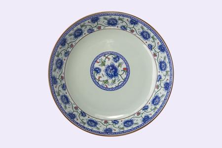 Foto de blue and white porcelain plate in white background - Imagen libre de derechos
