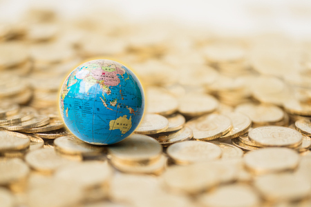 Photo for Earth model and gold coins - Royalty Free Image