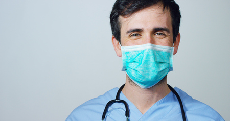 Foto de close up portrait of a surgeon or doctor with mask ready for operation in hospital or clinic. - Imagen libre de derechos
