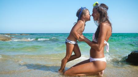 Foto de Mother and daughter hug and beautiful masks. - Imagen libre de derechos