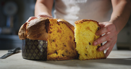 Foto de chef who controls the quality of his Italian panettone - Imagen libre de derechos