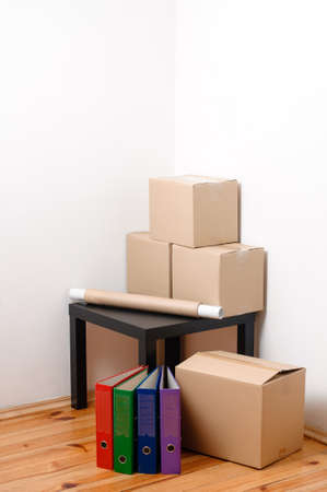 Photo for Moving day - cardboard boxes with table and files in room - Royalty Free Image