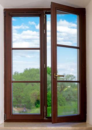 Photo pour wood plastic vinyl window on a background blue sky - image libre de droit