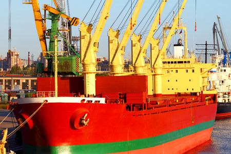 Sea cargo transportation. The ship in port. Trade business.
