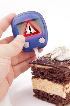 Blood Sugar Test with Warning Sign Metafor executed on piece of cake