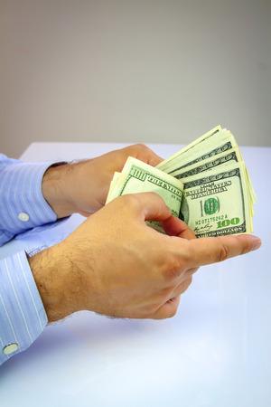 American dollars in hands. Money concept