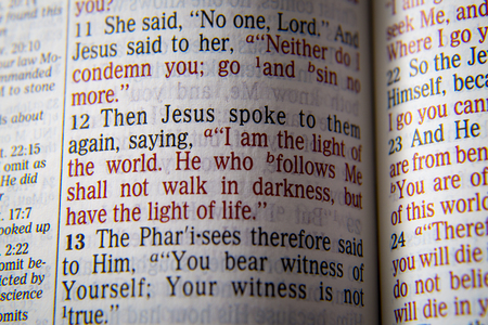 I am the light of the world. He who follows Me shall not walk in darkness, but have the light of life.Bible text from John 8:12, the Bible. Visual effects to emphasize the message. Macro