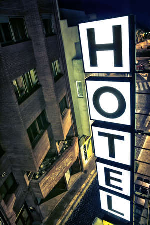 Illuminated hotel sign at night from a room