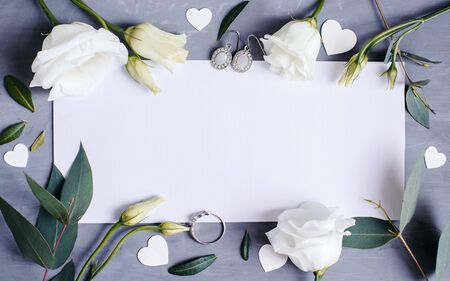 Photo for Blank paper copy space. Frame with flowers. Silk ribbon. Gray background. Simple bouquet. Greeting card - Royalty Free Image