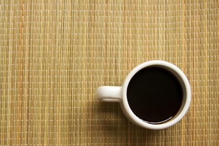 Coffee cup on straw background