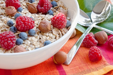 Oat nuts with fresh blueberries and raspberries and hazelnuts
