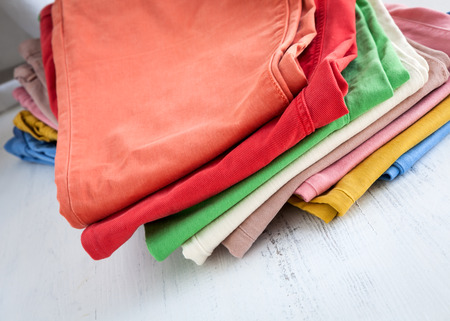 Colorful pants in white wooden table