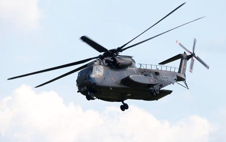 BERLIN / GERMANY - JUNE 3 2016: Sikorsky S-65, CH-53 transport helicopter flies in berlin, germany on june 3, 2016.