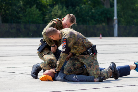 BURG / GERMANY - JUNE 25, 2016: german military police bodyguards defeats an assassin on an exercise in burg / germany at june 25, 2016